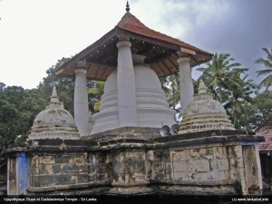 The main stupa with 4 satellite stupa. Underneath each satellite stupa is a small shrine room with a flower pedestals