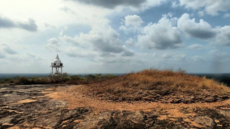 Remains of the ancient stupa and the and the new one at the top of  Kadiragala Rajamaha Viharaya rock.