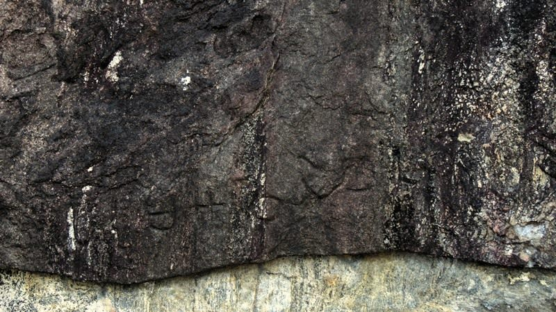 Inscriptions on the drip Ledge of the caves facing the Kanchikudichchi Aru Reservoir