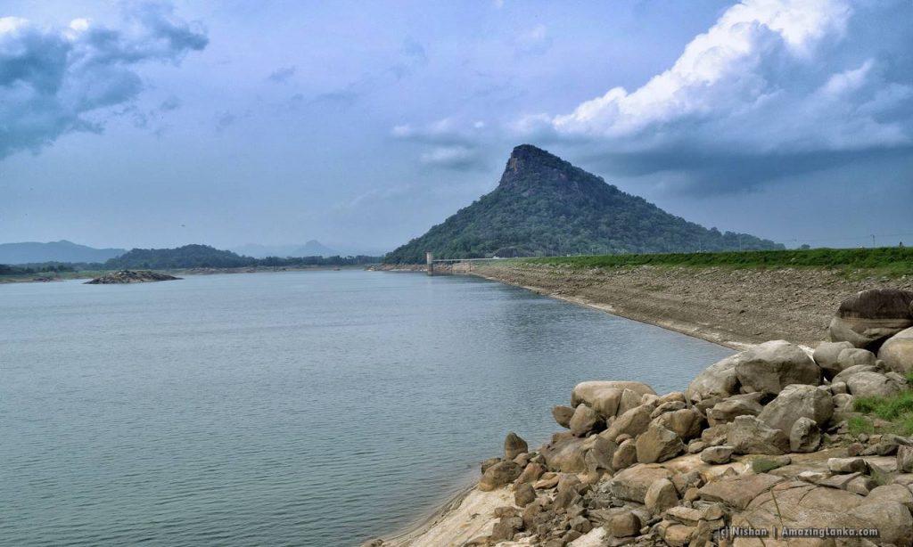 Senanayake Samudraya and with the Inginiyagala mountain rising majestically at the far end of the dam