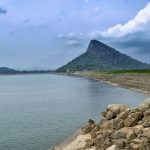 Senanayake Samudraya and with the Inginiyagala mountain rising majestically at the far end of the dam