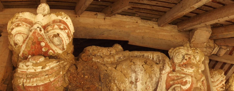 Deteriorated clay lion figures on the second floor of the temple building built during the Kandyan era