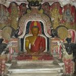 The main Samadhi statue with an elaborate Makara Thorana at the Algama Sri Sangharaja Rajamaha Viharaya