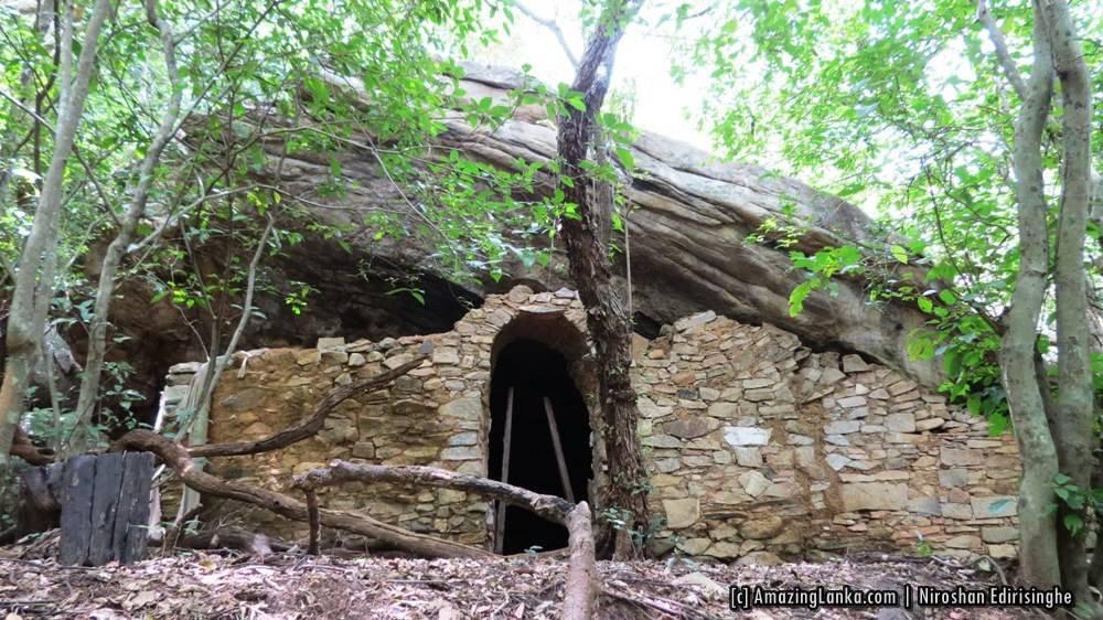 A drip ledge cave with ancient walls and entrance still intact at Manakanda ancient monastery